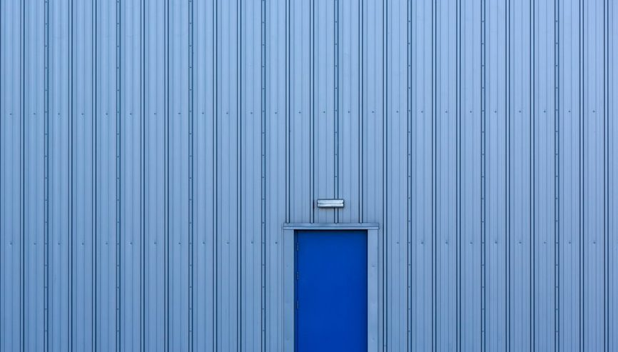 Blue door on blue wall